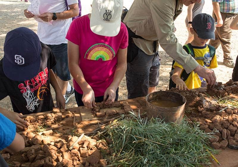 Fiesta de los Niños adobe making